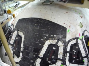 Above and facing the cockpit